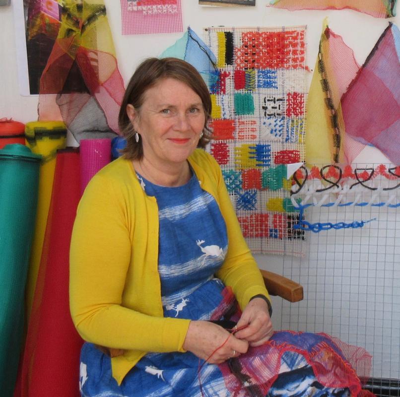 Dr Lynn Setterington – textile artist sitting
